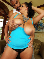 Beautiful plumper reveals her large juggs in blue dress - Picture 7