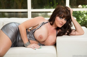 Bllack-haired lady with big boobs pleasures self on white couch. - XXXonXXX - Pic 14
