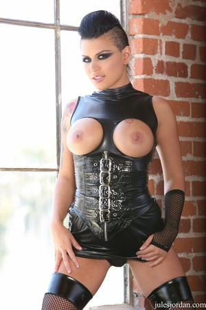 Edgy girl poses with tits outs and kinky leatherwear by the window. - XXXonXXX - Pic 1