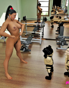 After her workout, ebony babe has two little men pleasure her.