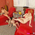Horny redhead sluts play with dildos and their servants in the lounge.