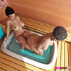 Two curvy women have fun using a man slave in the tub.
