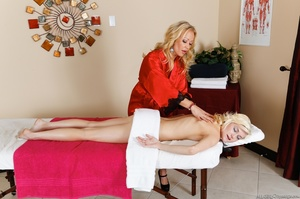 A tattooed blonde with large tits pleasures her lesbian lover during a massage - XXXonXXX - Pic 1
