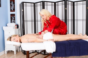 A busty blonde in red strips down and fucks another blonde with a strap-on - XXXonXXX - Pic 2