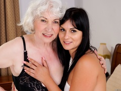Latina sucks a blonde caucasian granny's tits and - XXXonXXX - Pic 1