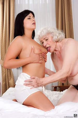 Latina sucks a blonde caucasian granny's tits and pussy in a white hotel room - XXXonXXX - Pic 4