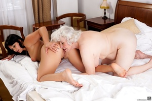 Latina sucks a blonde caucasian granny's tits and pussy in a white hotel room - XXXonXXX - Pic 11