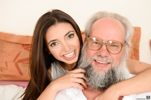 Old grandpa enjoyed sucking and banging a young brunette's pussy on white sheets - XXXonXXX - Pic 1
