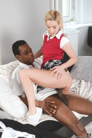 Blonde in her red uniform sucks and rides a black cock on a white couch - XXXonXXX - Pic 9