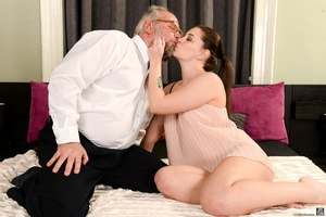 Old man sucks and fucks a young brunette's pussy on white sheets - XXXonXXX - Pic 2