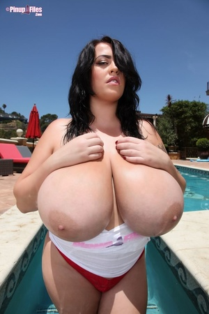 Chubby brunette removes her swimsuit and show her massive tits before dipping into the pool - XXXonXXX - Pic 6