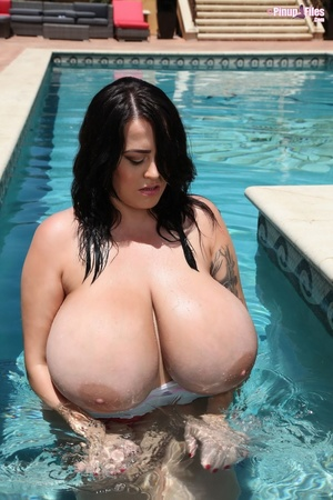 Chubby brunette removes her swimsuit and show her massive tits before dipping into the pool - XXXonXXX - Pic 8