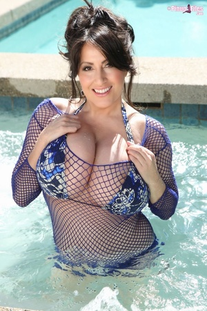 Beautiful brunette in blue swimsuit soaks herself in the pool and exposes her massive tits - XXXonXXX - Pic 2