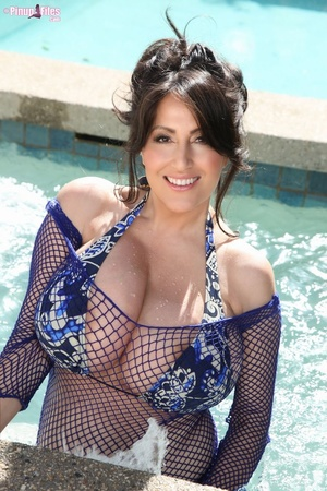 Beautiful brunette in blue swimsuit soaks herself in the pool and exposes her massive tits - XXXonXXX - Pic 3