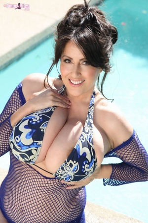 Beautiful brunette in blue swimsuit soaks herself in the pool and exposes her massive tits - XXXonXXX - Pic 5