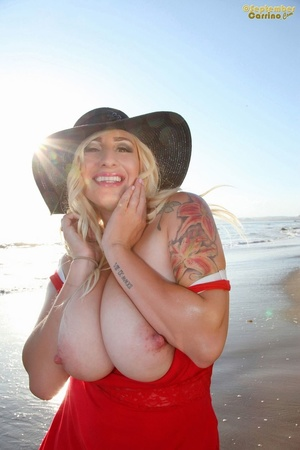 Plump blonde pin-up model gets her giant tits out at the beach in red dress - XXXonXXX - Pic 8
