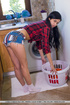 Brunette gets her laundry done while fucking herself beside the washing