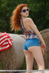 Red head slut brings the american flag and fucks herself outdoors beside
