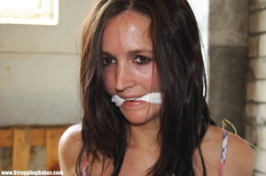 Brunette beauty in checkered dress roped, gagged and hog tied in barn - XXXonXXX - Pic 2