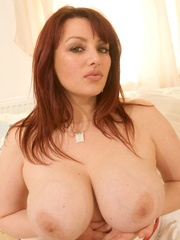 Plus size brunette takes off her blue blouse and white - Picture 5