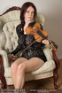 Busty brunette doll posing in black lace body and nude with violin