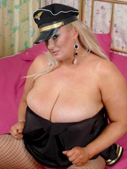 Fat police hottie in black hat, uniform, stockings and - Picture 3