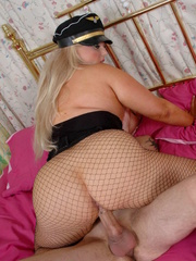 Fat police hottie in black hat, uniform, stockings and - Picture 12