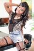 Leggy brunette t-girl in fishnets shows massive cock