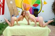 two denim-shorts-wearing girls posing