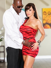 Brunette MILF wears a tight red dress and poses - XXXonXXX - Pic 1