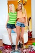 Colorfully dressed blondes in denim shorts posing