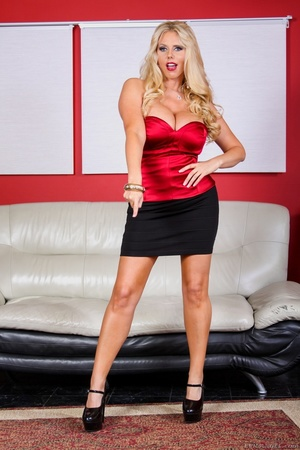 Black skirt and red top blonde domme posing and looking busty - XXXonXXX - Pic 2