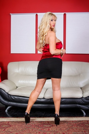 Black skirt and red top blonde domme posing and looking busty - XXXonXXX - Pic 9