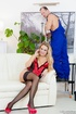 Long-haired blonde in red heels rides rigid cock on a white couch.