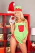 Blonde Christmas cutie takes off red panties to show off her waxed cunt.