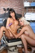 Brunette bitch in a ball gag shares a purple dildo with a sexy blonde