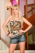 Sultry siren in black heels, short shorts and an animal-print top shows