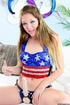 Cute patriotic blonde in sexy glittery outfit wears strap on dildo and