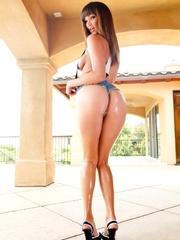 Young brunette wears suspenders between her oiled - XXXonXXX - Pic 3