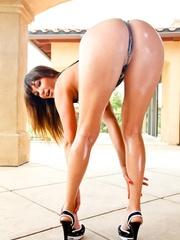 Young brunette wears suspenders between her oiled - XXXonXXX - Pic 4