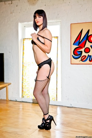 Provocative brunette with sexy face in black lingerie and fishnet stockings with slut heels kneels on the hard wood floor and shows her perky ass - XXXonXXX - Pic 3