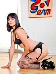 Provocative brunette with sexy face in black - XXXonXXX - Pic 10