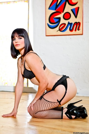 Provocative brunette with sexy face in black lingerie and fishnet stockings with slut heels kneels on the hard wood floor and shows her perky ass - XXXonXXX - Pic 10