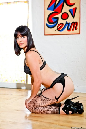 Provocative brunette with sexy face in black lingerie and fishnet stockings with slut heels kneels on the hard wood floor and shows her perky ass - XXXonXXX - Pic 11
