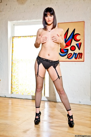 Provocative brunette with sexy face in black lingerie and fishnet stockings with slut heels kneels on the hard wood floor and shows her perky ass - XXXonXXX - Pic 15