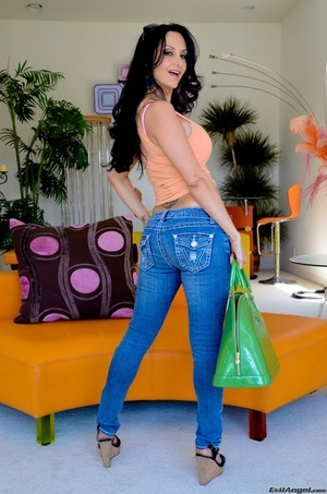 A brunette slut in jeans shows off her hot body for the camera - XXXonXXX - Pic 9