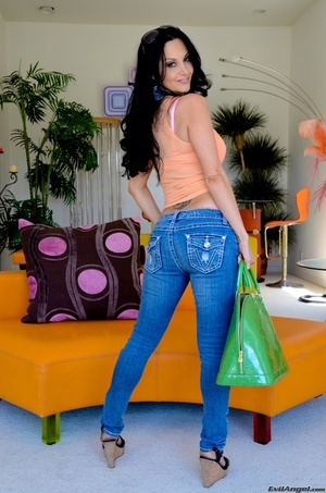 A brunette slut in jeans shows off her hot body for the camera - XXXonXXX - Pic 11