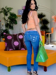 A brunette slut in jeans shows off her hot body - XXXonXXX - Pic 12