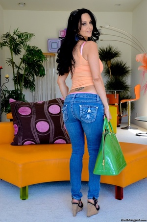 A brunette slut in jeans shows off her hot body for the camera - XXXonXXX - Pic 12