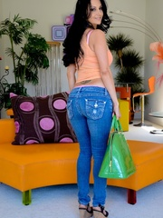 A brunette slut in jeans shows off her hot body - XXXonXXX - Pic 13